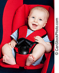 Happy boy in car seat