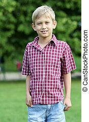 happy boy in park portrait