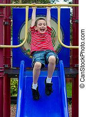 Happy boy in playground