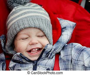 happy boy in stroller