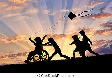 Happy boy in wheelchair playing with children and kite ...