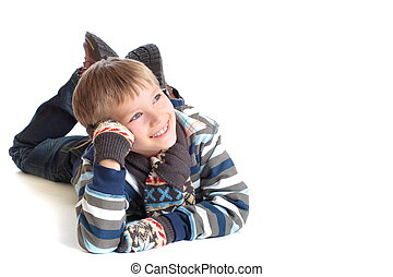 Cute, happy young boy in winter clothing.