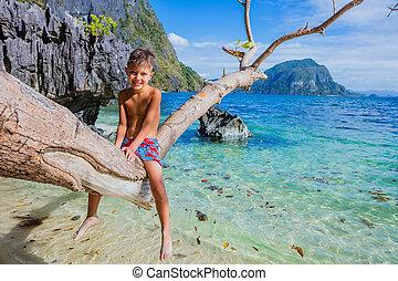 Happy boy on beach.