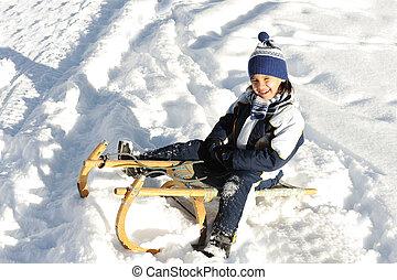 Happy boy on snow
