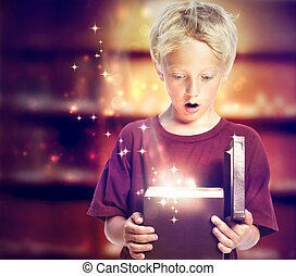 Happy Boy Opening a Gift Box - Happy Young Blond Boy Opening...