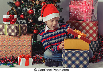 Happy boy opening a present box