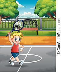 Happy boy playing tennis at the courts