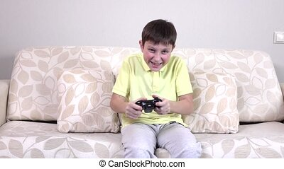Happy boy playing video games, slowmotion