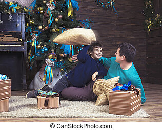 Happy boy playing with his father on Christmas