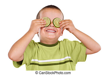 Happy boy playing with lime slices