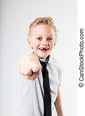 happy boy pointing out to you