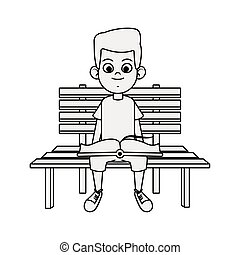 Happy boy reading a book sitting on bench