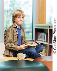 Happy Boy Reading Book In Library