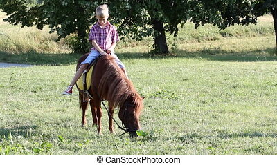 happy boy riding pony horse