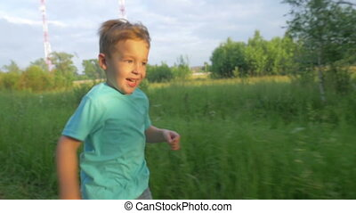 Happy Boy Running In The Park