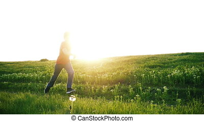 Happy boy running on green grass meadow