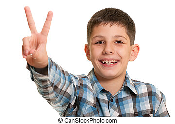 Happy boy showing a victory sign