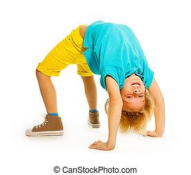 Happy boy showing acrobatic trick