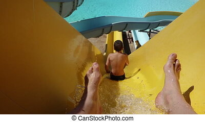 Happy boy slide on waterpark