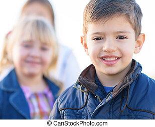 Happy Boy Standing In Front Of Girls