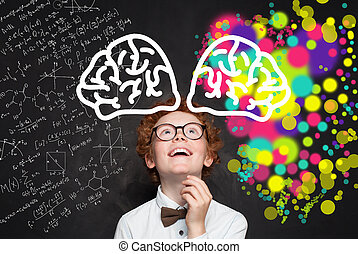 Happy boy student on blackboard with maths formula and art pattern. Creativity education with left and right hemispheres of the brain concept.