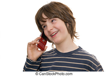 Happy boy talking on a mobile phone