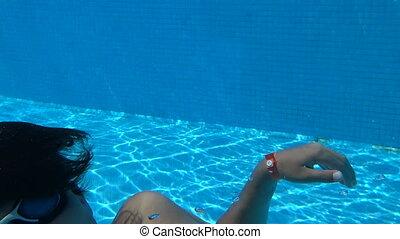 Happy boy underwater - Teenage boy on summer holiday dives...