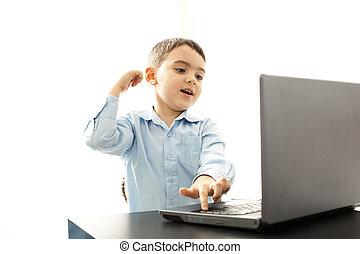 happy boy using laptop