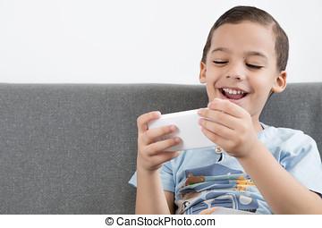 Happy boy using mobile.