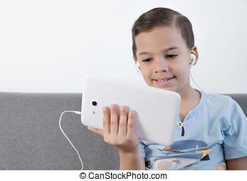 Happy boy using tablet.