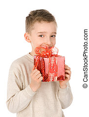Happy boy with a red gift box