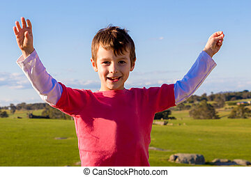 Happy Boy with Arms Up