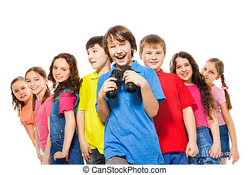 Happy boy with binoculars in a group