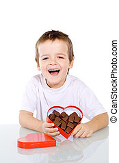 Happy boy with chocolate