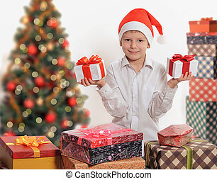 Happy boy with christmas gift box.