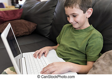 Happy boy with computer