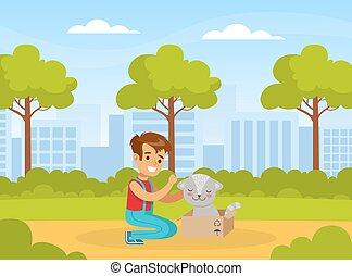 Happy Boy with Cute Cat in Box, Child Walking in Park Cartoon Vector Illustration