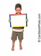 adorable seven year old boy holding blank dry erase board