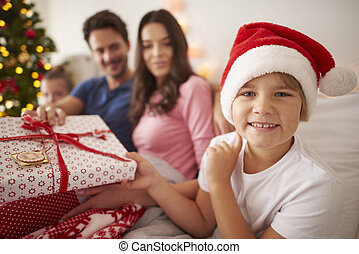 Happy boy with family in Christmas time