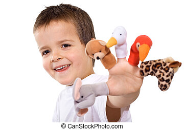 Happy boy playing and showing his finger puppets - isolated