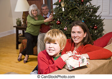 Happy boy with mom and grandparents at Christmas - Happy boy...