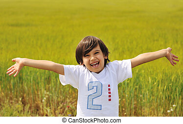 Happy boy with open arms outdoor