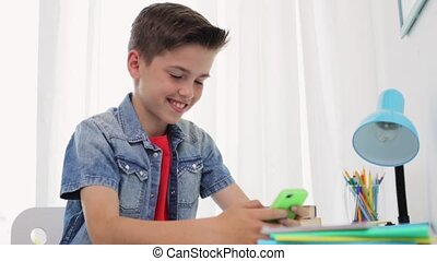 happy boy with smartphone at home - people, technology and...