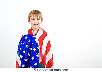 Happy boy with USA flag isolated over white background. Happy child holds a flag of America.