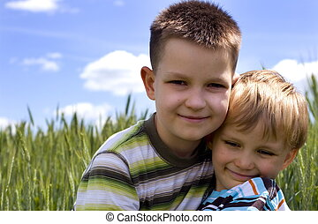 happy boys - children on a meadow