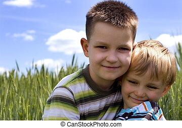 happy boys - children on a meadow