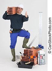 Happy  bricklayer, studio shot