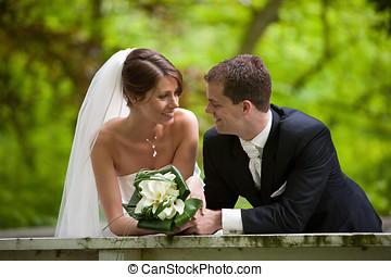 Happy bride and groom - Beautiful bride and groom looking...