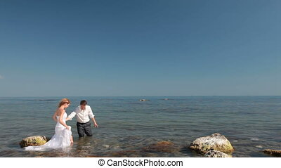 happy bride and groom by the sea