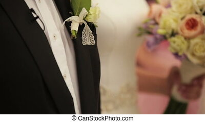 Happy bride and groom holding bouquet. Wedding ceremony
